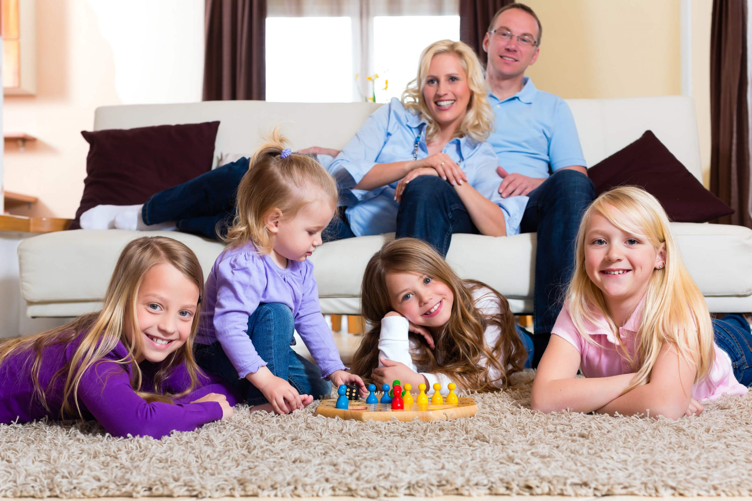 family playing game on clean carpet in Tulsa